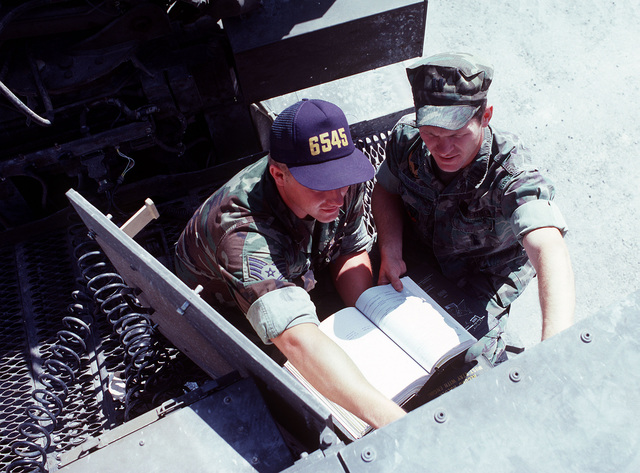 SSGT Dave Hillman and CPT Rick Sample man the control panel of a transporter-erector-launcher at the Integrated Maintenance Facility. The Air Force is conducting a test and evaluation program for the ground-launched cruise missile's weapon system