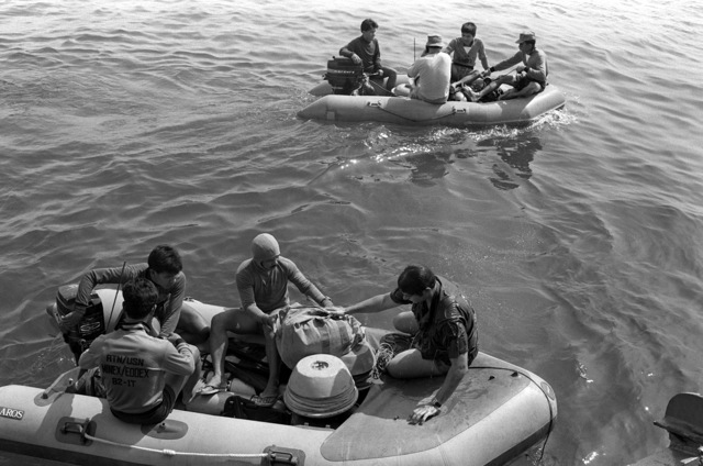 Two rubber rafts, carrying combined Royal Thai navy and U.S. Navy Explosive Ordnance Disposal teams, depart the support ship on mine recovery operations during Exercise Cobra Gold '82