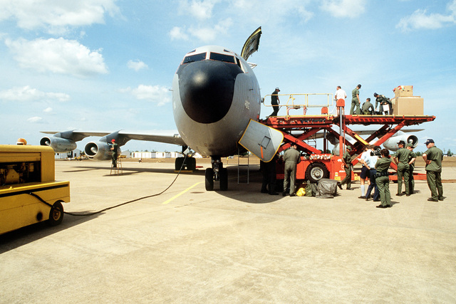United States and Royal Australian Air Force members unload cargo from a KC-135 Stratotanker aircraft. The aircraft, assigned to the 906th Air Refueling Squadron, 43rd Strategic Wing, Pacific Task Force, is participating in Exercise Glad Customer '82