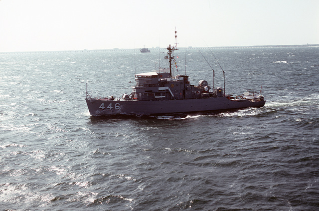 Aerial port beam view of the ocean minesweeper USS FORTIFY (MSO-446) underway