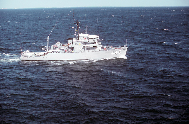 An aerial starboard beam view of the ocean minesweeper USS FORTIFY (MSO-446) underway