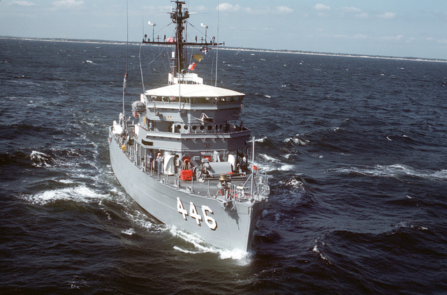 An aerial starboard bow view of the ocean minesweeper USS FORTIFY (MSO-446) underway