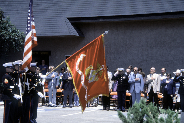 Some of the residents of the city salute the U.S. flag as the Marine color guard from the Marine Barracks, Vallejo, California, 12th Marine Corps District, presents the colors during a flag pageant at the Elks Lodge (BPOE)