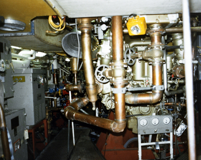 A view of a machinery room, starboard aft looking forward, aboard the PCG-612 class patrol chaser, missile, hull no. 616 at 90 percent completion
