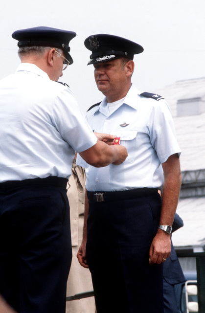 Colonel (COL) Robert N. Clark receives the Legion of Merit from Major General Donald W. Bennett, Commander of the 22nd Air Force, during the change of command ceremony for the 316th Tactical Airlift Group. COL Lowell G. Fathers will succeed COL Clark as the 316th TAG commanding officer