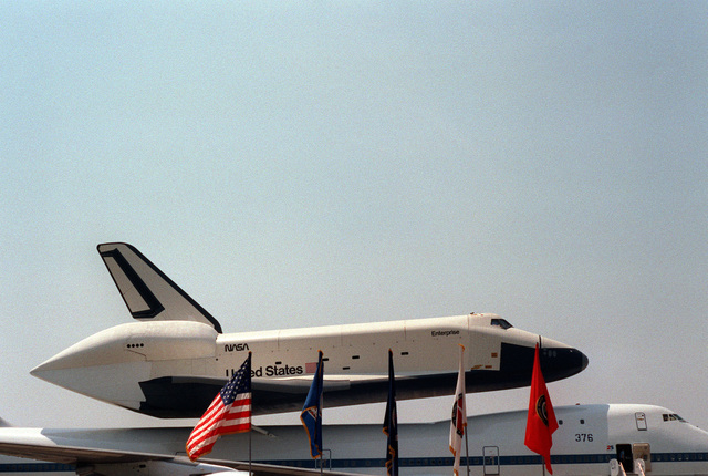 A right side view of the STS space shuttle Enterprise on the back of a National Aeronautics and Space Administration Boeing 747 aircraft, during a public display to celebrate the Air and Space Bicentennial