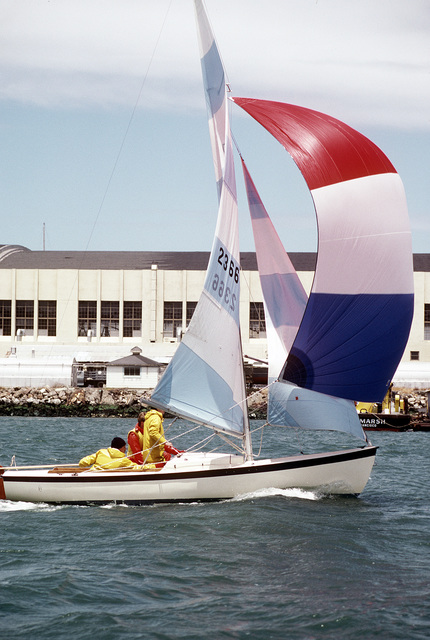 A sail boat under full sail takes part in the Treasure Island Yacht Club sailing tournament. The Naval Air Station, Lemoore, California sailing team is a participant in the race