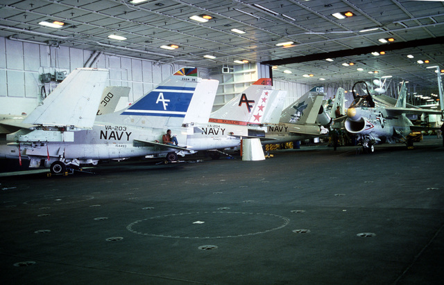 A-7B Corsair II aircraft in the hangar bay of the nuclear-powered aircraft carrier USS CARL VINSON (CVN 70). The aircraft are assigned to Light Attack Squadrons 203, 204, and 205 (VA-203, 204, 205)