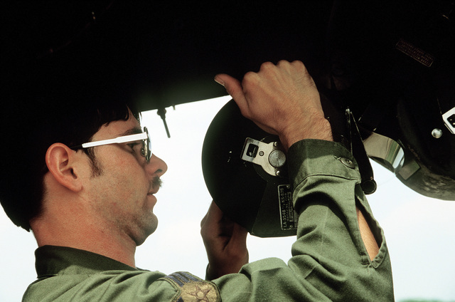 SRA Dwight T. Tipton, an avionics sensor system specialist with the 363rd Aircraft Generation Squadron, loads film into the forward KS-87B forward camera aboard an RF-4C Phantom II aircraft during Exercise Salty Bee