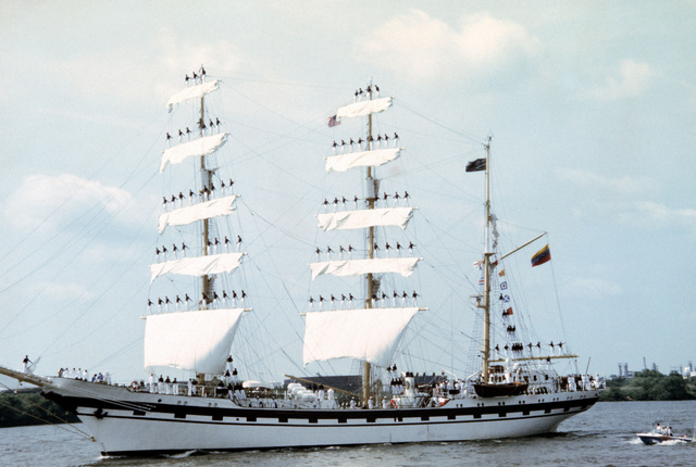 A port bow view of the Venezuelan training ship SIMON BOLIVAR with sails set and cadets manning the rigging as it prepares to dock for the Century IV celebration
