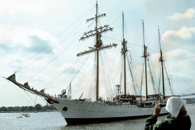 A starboard bow view of the Chilean training ship ESMERALDA, with cadets manning the rigging as she prepares to dock for the Century IV celebration. View is from the deck of the Navy tug MENASHA (YTM-761) with a civilian guest aboard taking pictures