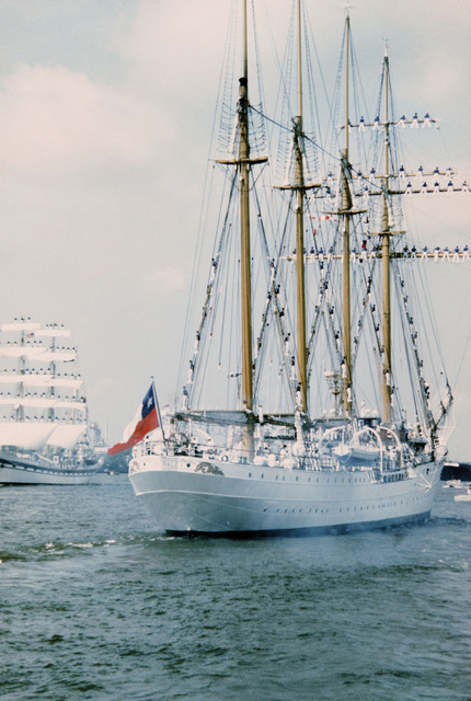 A starboard quarter view of the Chilean training ship ESMERALDA with cadets manning the rigging as it prepares to dock for the Century IV celebration