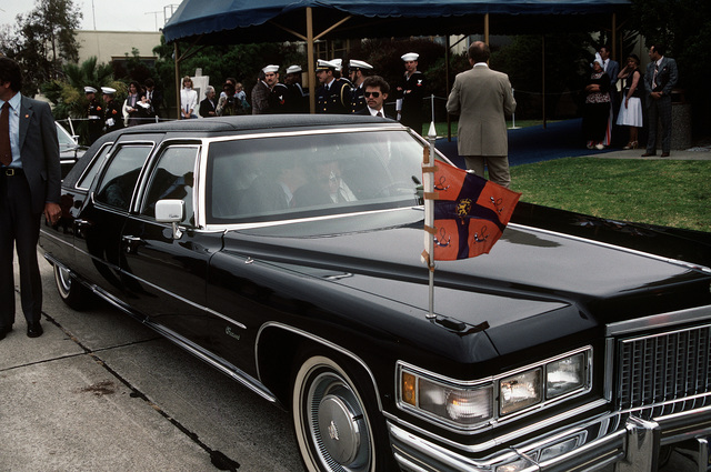 A limousine waits to take the royal party from the Netherlands, His Royal Highness, Prince Claus, and Her Majesty, Queen Beatrix, away from the air terminal