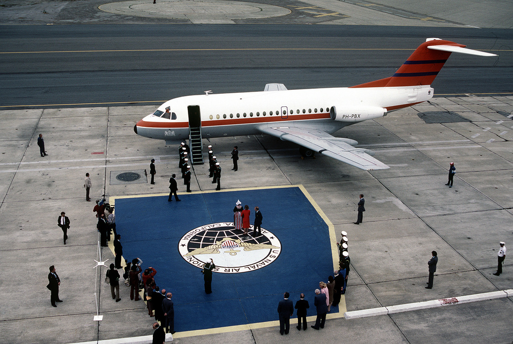 Navy sideboys stand by to pay honor to the queen of the Netherlands, Her Majesty, Queen Beatrix, as she arrives for a visit. The queen arrived aboard a Fokker F-28 Fellowship aircraft