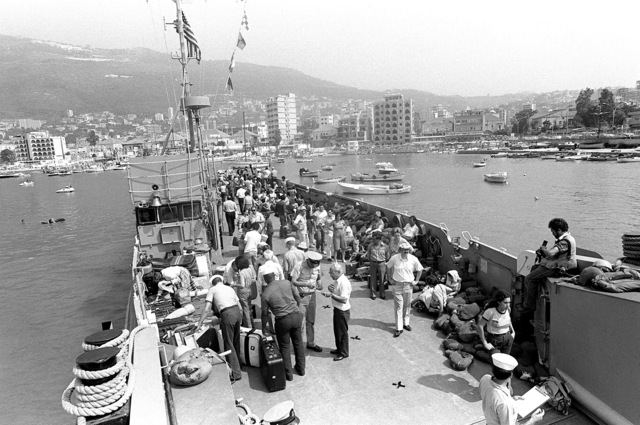 A utility landing craft, with evacuees aboard, begins the trip from the pier out to a U.S. Navy amphibious ship. Approximately 600 Americans and third nation personnel are being evacuated from Beirut with the aid of LCUs