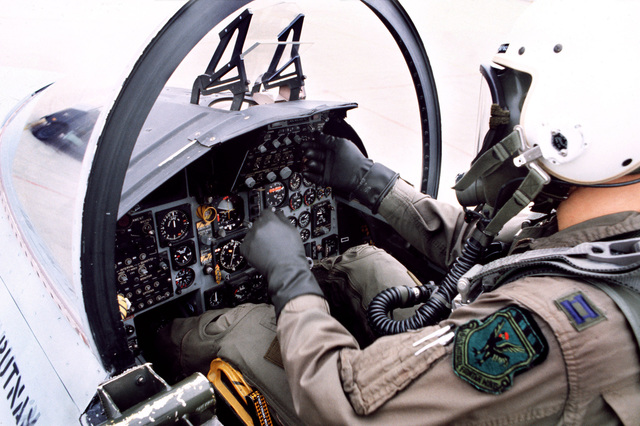 Captain Doug Moss does a pre-flight cockpit check of his F-15D Eagle aircraft during the Hughes Aircraft Company's Trophy activities
