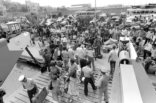 Evacuees begin to board a utility landing craft, for their transfer to a U.S. Navy amphibious ship. Approximately 600 Americans and third nation personnel are being evacuated from Beirut