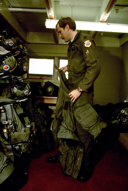 A member of the 183rd Tactical Fighter Group stores away his flight gear after a day's participating in Exercise Coronet Brave