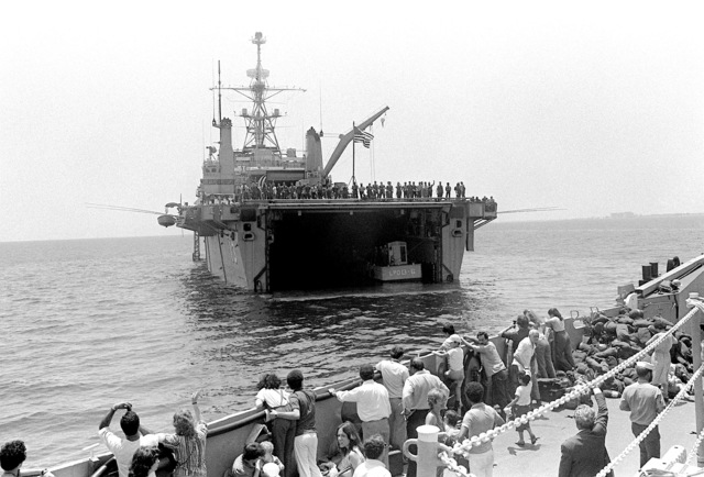 A utility landing craft, filled with evacuees, departs the amphibious transport dock USS NASHVILLE (LPD-13). Approximately 600 Americans and third nation personnel have been evacuated from Beirut and transferred here