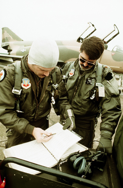 Preparations are made by members of the 183rd Tactical Fighter Group, prior to a training flight aboard an F-4D Phantom II aircraft during Exercise Coronet Brave