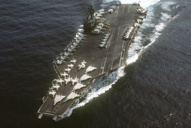 A port bow view of the aircraft carrier USS JOHN F. KENNEDY (CV-67) underway