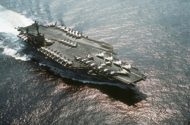 A starboard bow view of the aircraft carrier USS JOHN F. KENNEDY (CV-67) underway