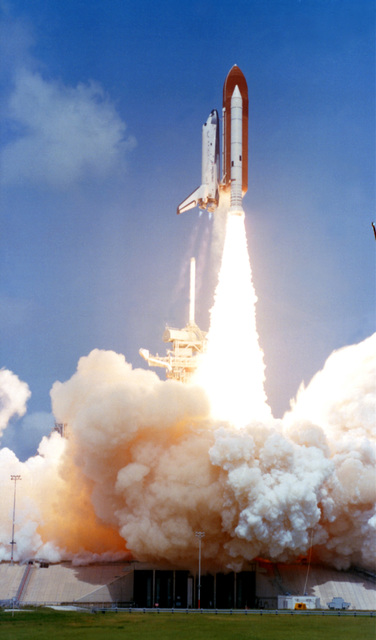 A view of STS-4 lifting off from launch pad 29A for a seven-day earth orbital mission and the final developmental flight for the Space Transportation System