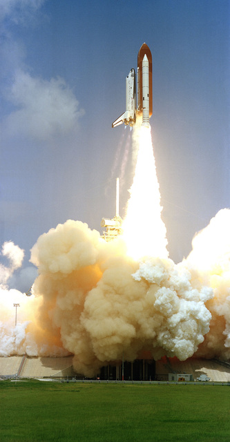 The space shuttle orbiter Columbia lifts off from Complex 39A at 10:59 a.m. EDT. Aboard for the Space Transportation System (STS-1) mission are astronauts Ken Mattingly, Commander, and Henry Hartsfield, pilot