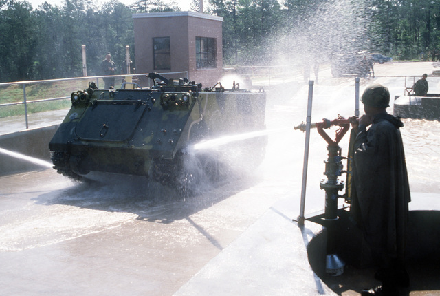 A view of the new Automated Tactical Vehicle washing facility in operation. The facility will be used to remove mud and sediment from tactical vehicles returning from training areas