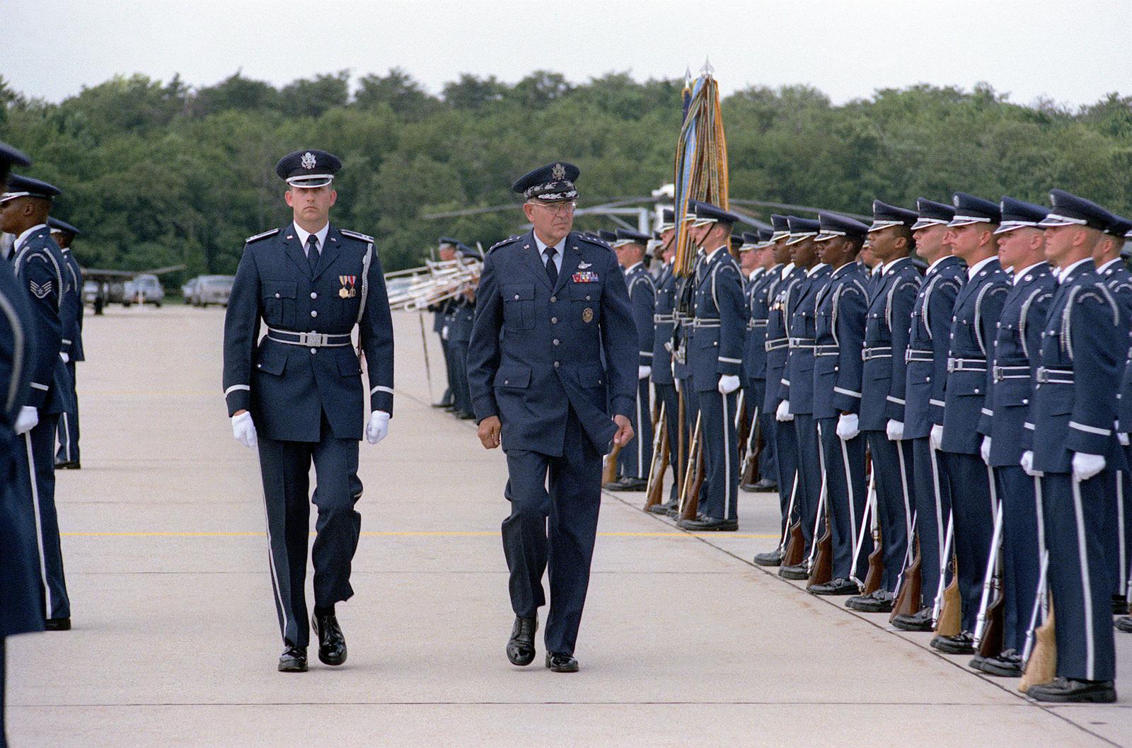 GEN Lew Allen Jr , right, inspects the Air Force personnel