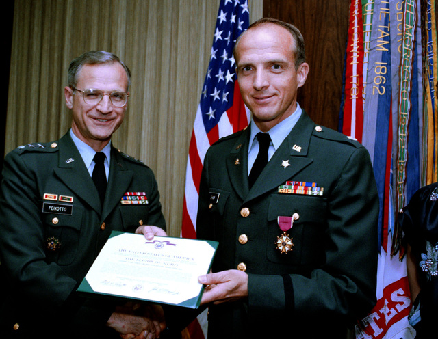 Lieutenant Colonel Stanley Lyn Shaw, Operations Research officer, Office of the Comptroller, receives the Legion of Merit from Lieutenant General Ernest D. Peixotto, comptroller of the Army