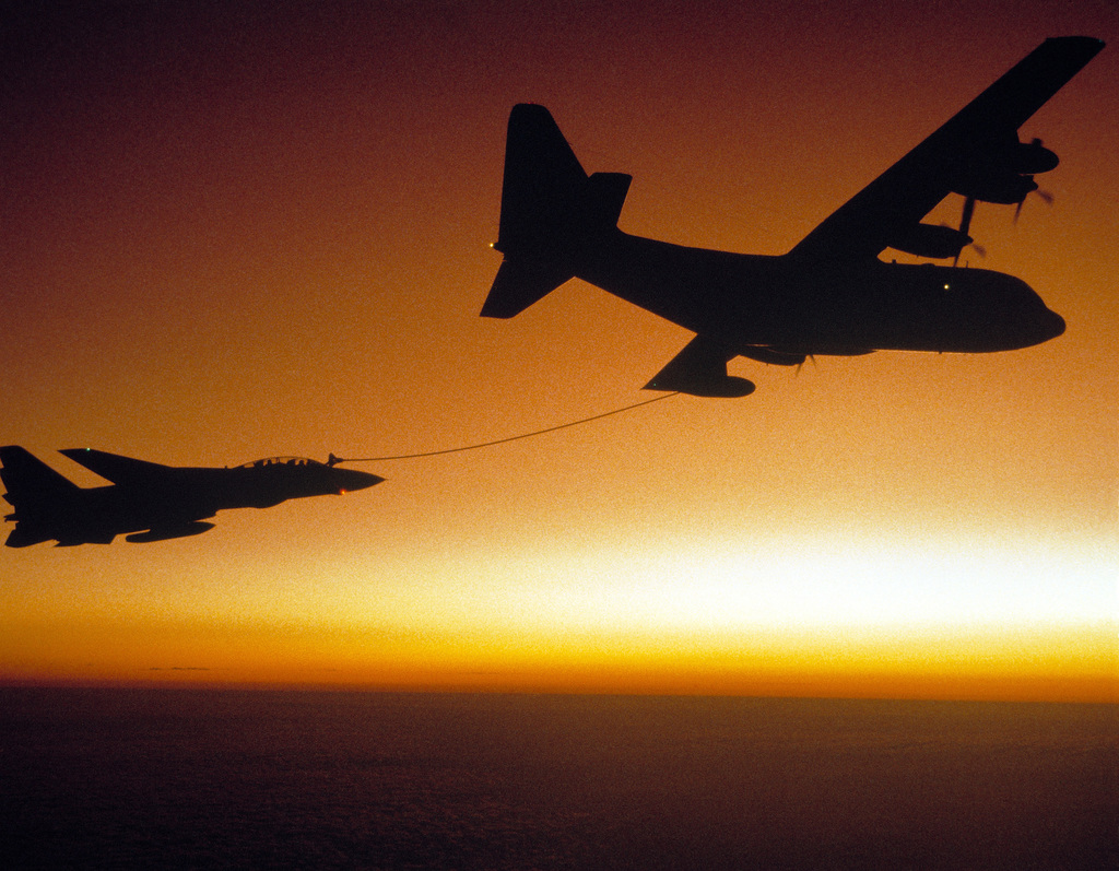 A KC-130 Hercules aircraft conducts in-flight refueling with a Fighter Squadron 24 (VF-24) F-14A Tomcat aircraft