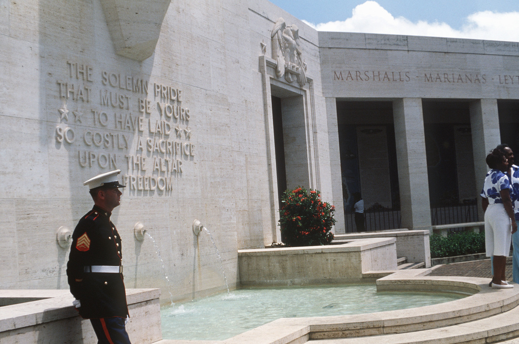 A Marine from the PHOTO Section, Marine Corps Air Station, visits the National Memorial Cemetery of the Pacific at Punch Bowl