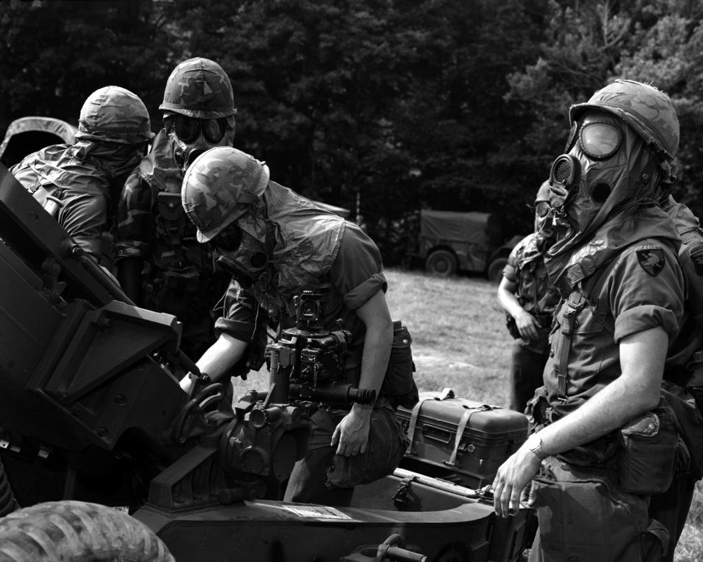 Cadets wear chemical warfare gear during artillery training
