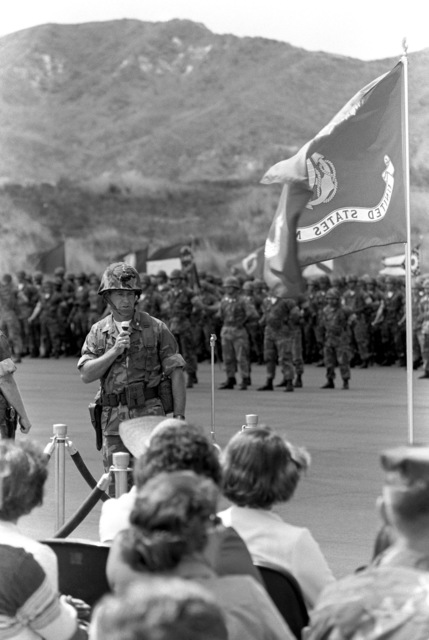 COL John A. Studds speaks to the Marines and guests attending his change of command ceremony. He relieved COL Thomas F. Qualls as commanding officer of the 1ST Mar. Regt., 1ST Mar. Div., Fleet Marine Force