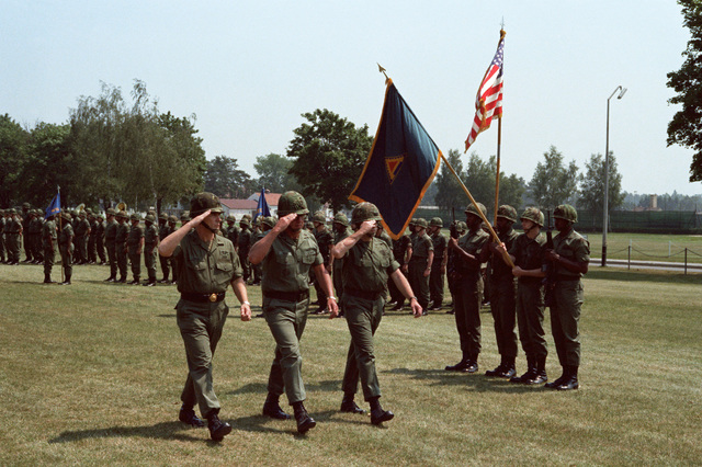 General Kroesen, Brigadier General (BGEN) Foss, and Colonel Coffman salute the flag as they pass in review, during a change of command ceremony in which BGEN Foss will assume the duties as 7th Army Training Commander