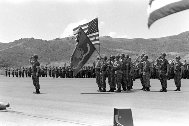 Retiring COL Thomas F. Qualls, commanding officer of the 1ST Mar. Regt., 1ST Mar. Div., Fleet Marine Force, presents his staff during his change of ceremony. He was relieved by COL John A. Studds
