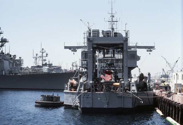 Stern view of the docked test range support ship USS ELK RIVER (IX-501)