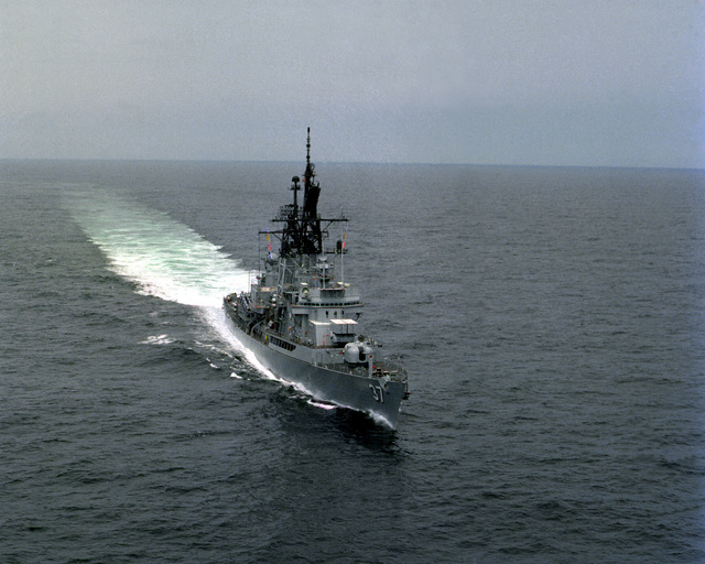 Aerial starboard bow view of the guided missile destroyer USS FARRAGUT (DDG-37) underway