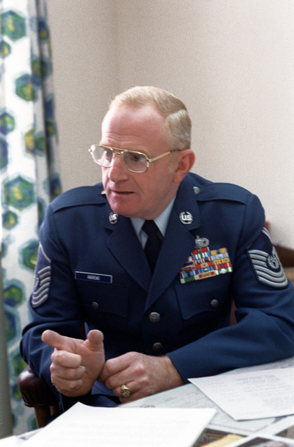 Candid photo of CMSGT Arthur L. Andrews in his office