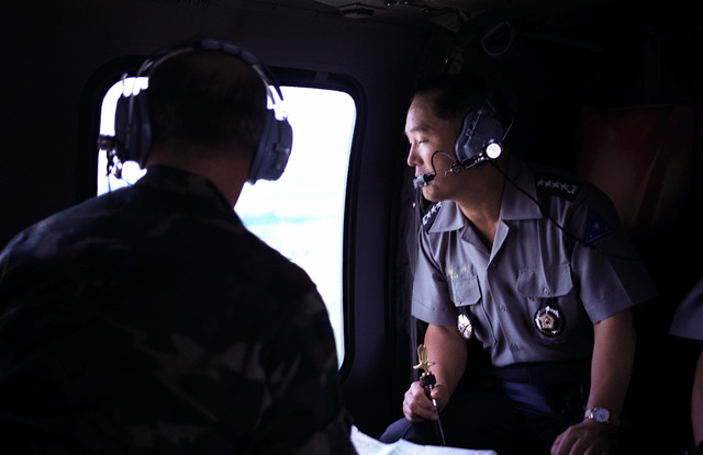 GEN Yung Si Wang, right, chief of staff of the Korean army, and BGEN G.H. Bethke, assistant division commander, observe an AH-1 Cobra helicopter from the 229th Airborne Helicopter Battalion participating in target practice at Range 42