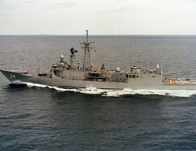 Aerial port beam view of the Oliver Hazard Perry class guided missile frigate USS AUBREY FITCH (FFG 34) underway