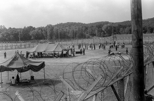 Members of the 13th Psychological Operations Battalion undergo riot control training at a mock prisoner of war camp