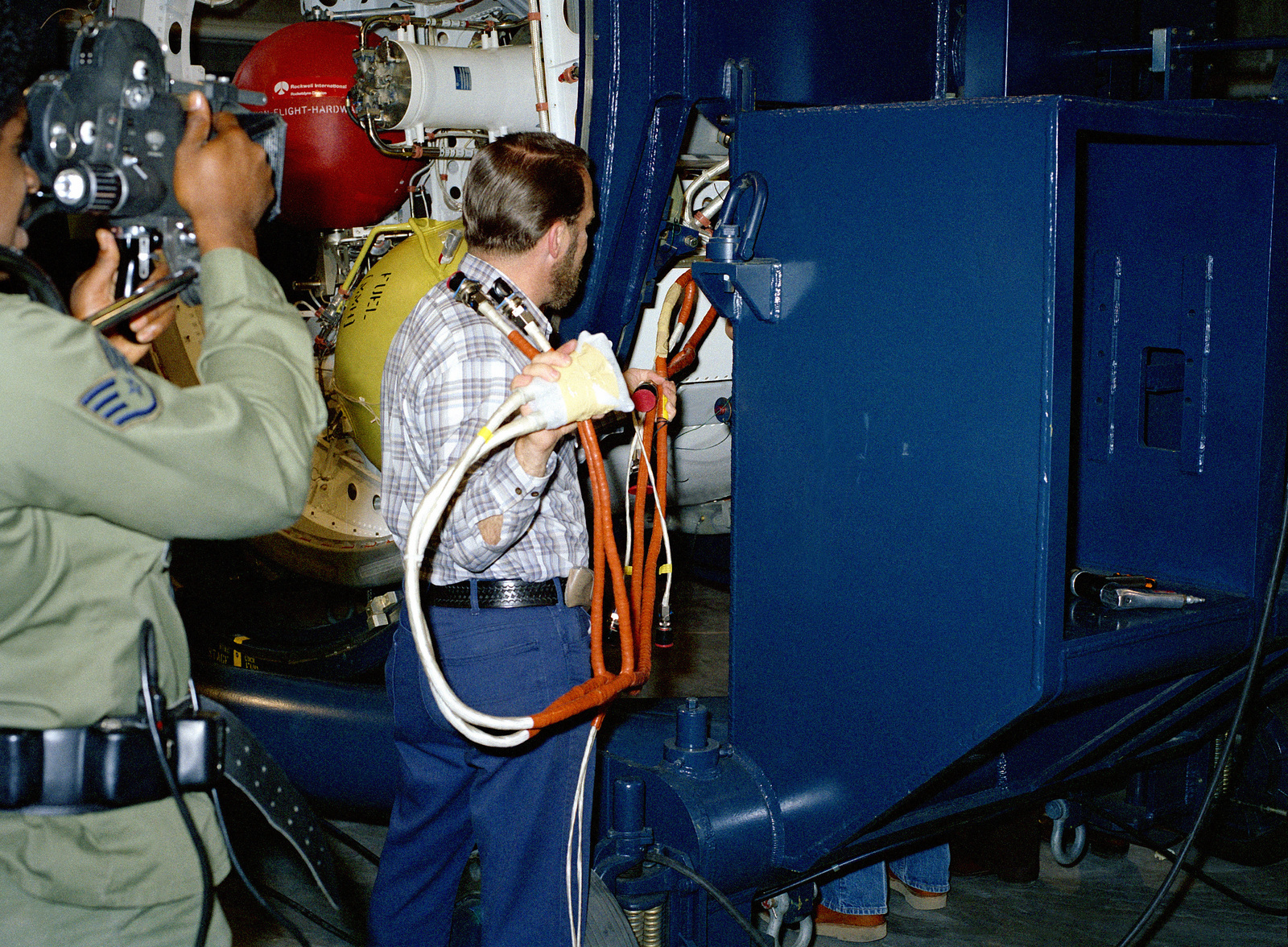Technicians Feed The Wire Harness Into Topside Of Stage Four Aerospace Wiring Destruct Package For Mx Pathfinder Missile