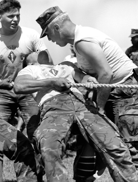 LCPL R.A. Lohroff of Communication Company, Headquarters Battalion, shouts at LCPL Gomer of Truck Company, to pull harder, during the tug of war competition. The 1ST Marine Division is having a field meet