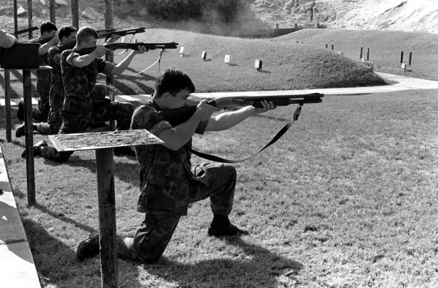 Marines of the station are given a familiarization class on firing the shotgun