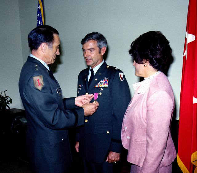 MGEN Louis C. Menetrey presents the Legion of Merit to LCOL William Vinson upon his retirement. Looking on is Mrs. Vinson. The ceremony was held at the Pentagon