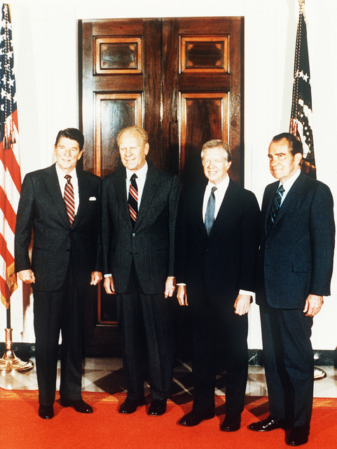 A full length portrait of President Ronald W. Reagan, left, with former Presidents Gerald R. Ford, James E. Carter and Richard M. Nixon