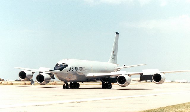 A left front view of a KC-135R Stratotanker aircraft retrofitted with the new CFM-56 engine parked on the runway apron