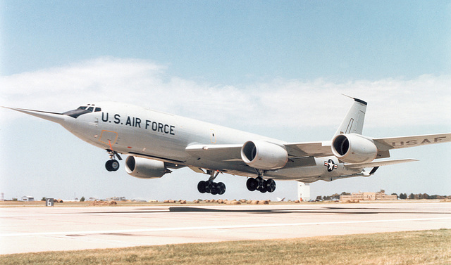 A left side view of a KC-135R Stratotanker aircraft retrofitted with the new CFM-56 engine, taking off